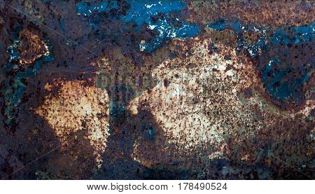 abstract grunge texture of rusty iron with beige, brown and blue spots horizontal