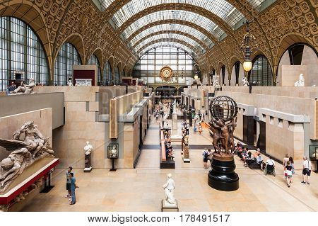 Paris France - Jule 08 2016: Main hall of the Orsay Museum. The Musee d'Orsay is a museum in Paris on the left bank of the Seine river. Musee d'Orsay has the largest collection of impressionist paintings in the world.