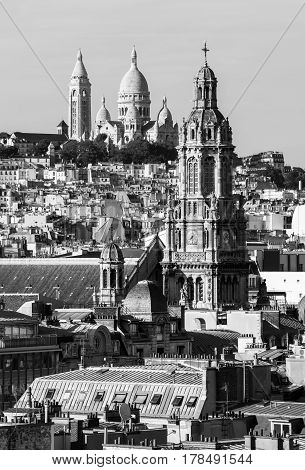 Panorama of Paris: The Sainte-Trinite and Sacre-Coeur churches.View of Paris from the rooftop of the building in the summer sunset in black and white. Paris France