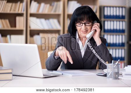 Mature businesswoman working in the office