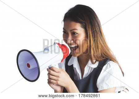 Businesswoman shooting through a megaphone on white background