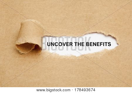 Text Uncover The Benefits appearing behind ripped brown paper.