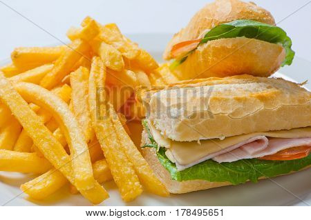 Sandwich With Ham, Tomato, Cheese And Golden French Fries Potatoes