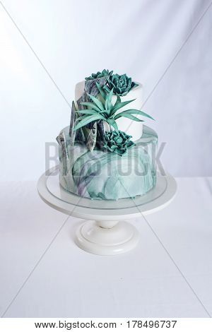 Wedding Cake Decorated Like A Stone Marble With Green Flowers