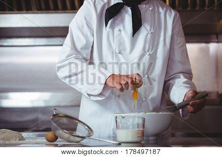 Focused chef preparing a cake in the restaurant kitchen