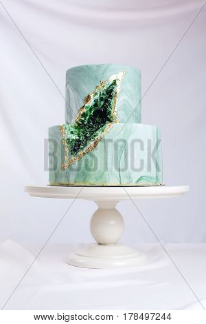 Wedding Cake Decorated Like Stone Marble With Emeralds In Cut