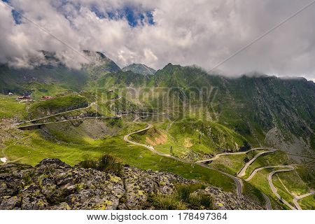 Landscape with the winding Transfagarasan road in Fagaras Mountains in Romania in a summer day. One of the most spectacular roads in the world.