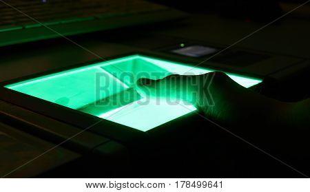 green cybersecurity digital fingerprint scanning on a green screen