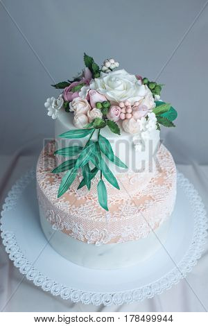 Spring Two-tiered Cake Decorated With Roses From Mastic Top