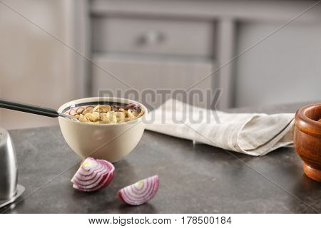 Bowl of chicken noodle soup served on table for dinner