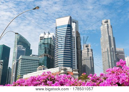 Afternoon view skyline or downtown of Marina Bay a beautiful landmark in Singapore shot at street walk on Anderson Bridge.