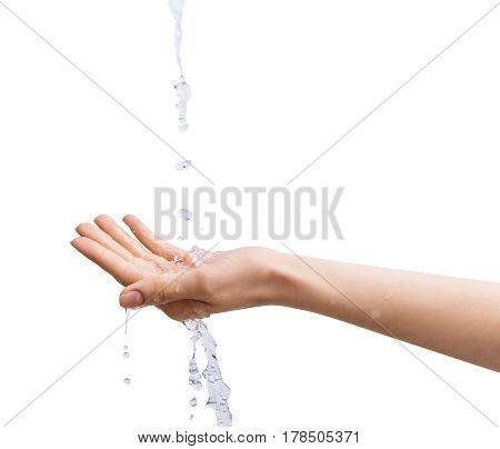 Female hand under the stream of water over white background.