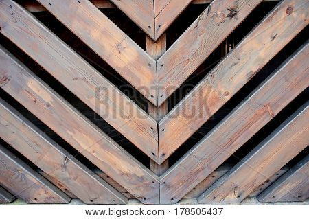 Oblique wooden slats.Bonded at an angle of 45 degrees. Fence, fencing