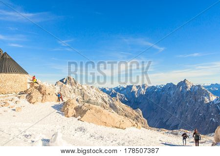 GARMISCH-PARTENKIRCHEN GERMANY - DECEMBER 10 2016: Group of Germany's seniors enjoying fresh air on Zugspitze peak 2962m high. Happy life in European Union Zugspitze in Garmisch Partenkirchen Germany