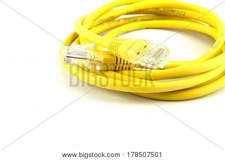 The yellow computer cable on the white background