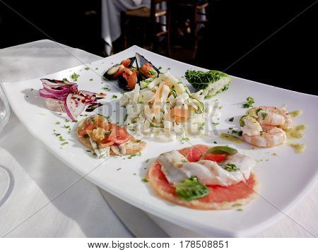Hot and cold snacks from barnacles fish and shrimp. The Mediterranean cuisine of Italy.
