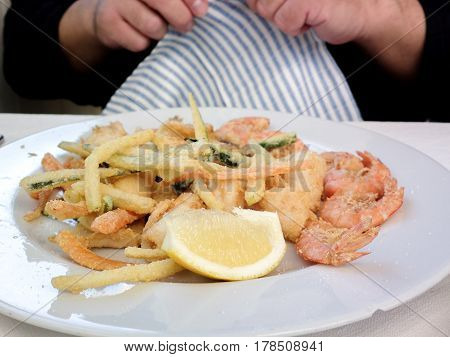 Hot and cold snacks from barnacles, fish and shrimp. The Mediterranean cuisine of Italy.