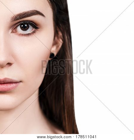 Half-face portrait of beautiful sensual woman over white background
