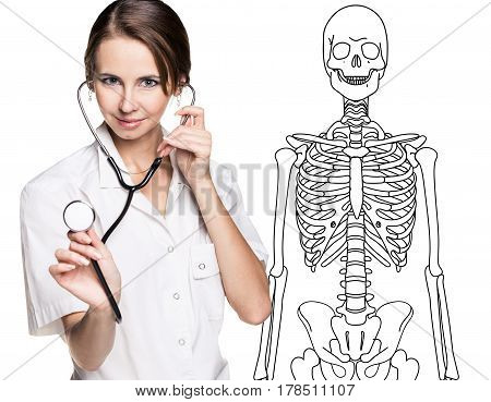 Medical doctor woman pointing on drawing human skeleton, isolated on white.