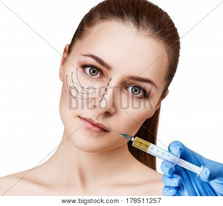 Woman face and hand in glove with syringe making injection. Plastic surgery and beauty concept.