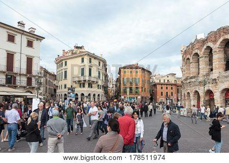 Tourists Walking Around The Piazza Bra Square In Verona