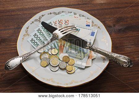 US dollars euros russian rubles and a big choice of dofferent coins on the vintage plate