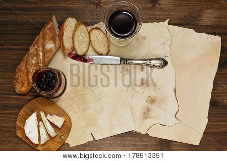 Simple and refined supper on background of old burnt and tattered paper sheets