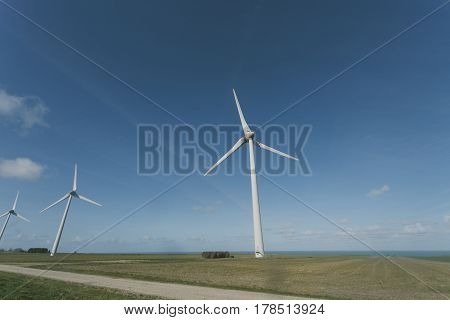 Wind turbines of a power plant for electricity generation in Normandy France. Concept of renewable sources of energy. Environmentally friendly electricity production. Toned