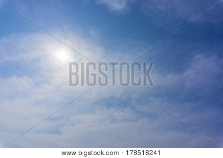 Blue sky with clouds and sun. Summer time.