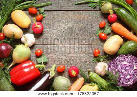 Assortment of vegetables pepper baclaran tomatoes zucchini carrots on wooden boards in a rustic style