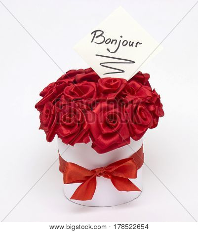 A bouquet of red roses made from satin ribbon with an inscription