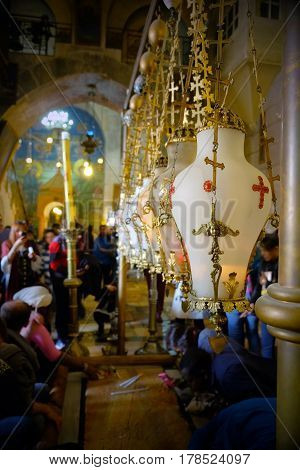 JERUSALEM ISRAEL - MARCH 25 2017: Lampades over the stone of Chrismation in the Church of the Holy Sepulcher
