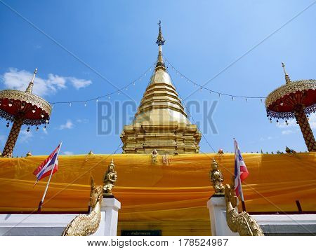 Thai pagoda at Wat Phra That Doi Kham (Temple of the Golden Mountain) in Chiang Mai Thailand