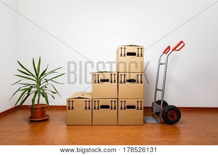 Stacked Cardboard Boxes In Front Of A Sack Barrow