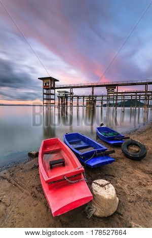Fishing boats on the beach with nice sunset sky