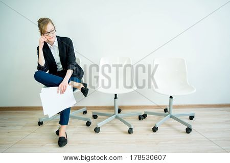 A woman candidate is waiting for her job interview