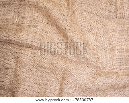 Old rural burlap vintage background, photo top view. Hessian, sacking texture, background for your design. Copy space for your message.