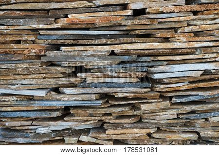 Texture, background, decorative flagstone stacked in a pile