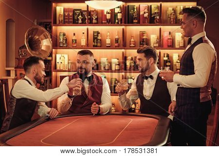 Group of upper class men toasting in gentlemen's club