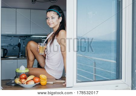Attractive Woman Making Fresh Juice At The Villa. View From The Window. Morning Concept