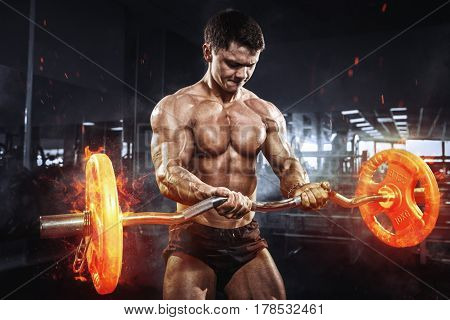 Muscular Athlete Bodybuilder With Burning Barbell Concept In Gym