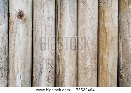 Wooden wall from logs as a background texture, natural patterns.