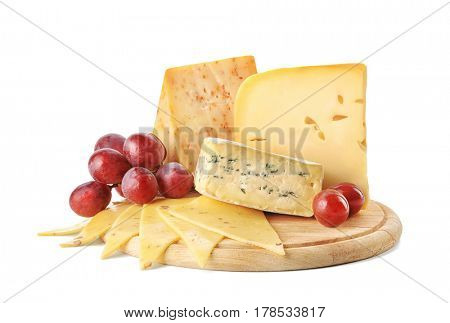 Wooden board with tasty cheese on white background