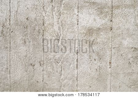 Asphalt close-up, concrete wall texture. Raw plaster wall background.