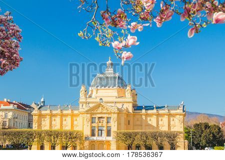 Spring in Zagreb, Croatia, tree blossom and art pavilion on king Tomislav square