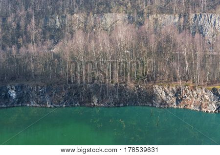 Panoramic view of an old open opencast mine of limestone works in Wuelfrath Germany on a winter day.