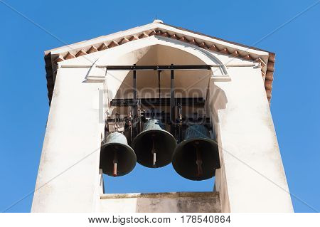 Old small bell tower. Three bell on belfry.