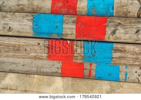 Old scaffolding planks on construction site wooden background