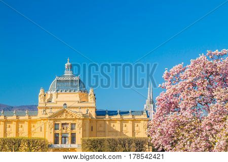 Panoramic view on art pavilion, cathedral and Japanese cherry blossom in Zagreb, Croatia, in spring