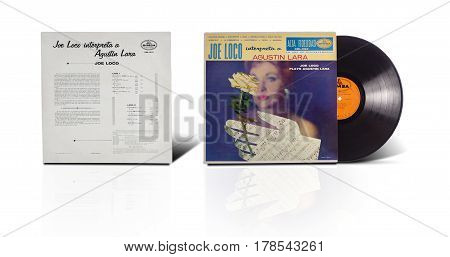 Rishon LeZion Israel-August 31 2016: Old vinyl album Joe Loco interpreta a Agustin Lara. Manufactured in Mexico by DIMSA Record. Covers and vinyl disc are shooted on white background